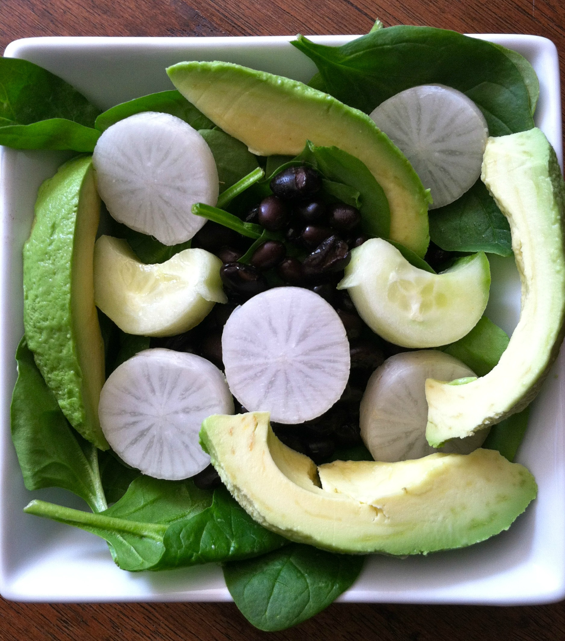 Spinach with black bean salad